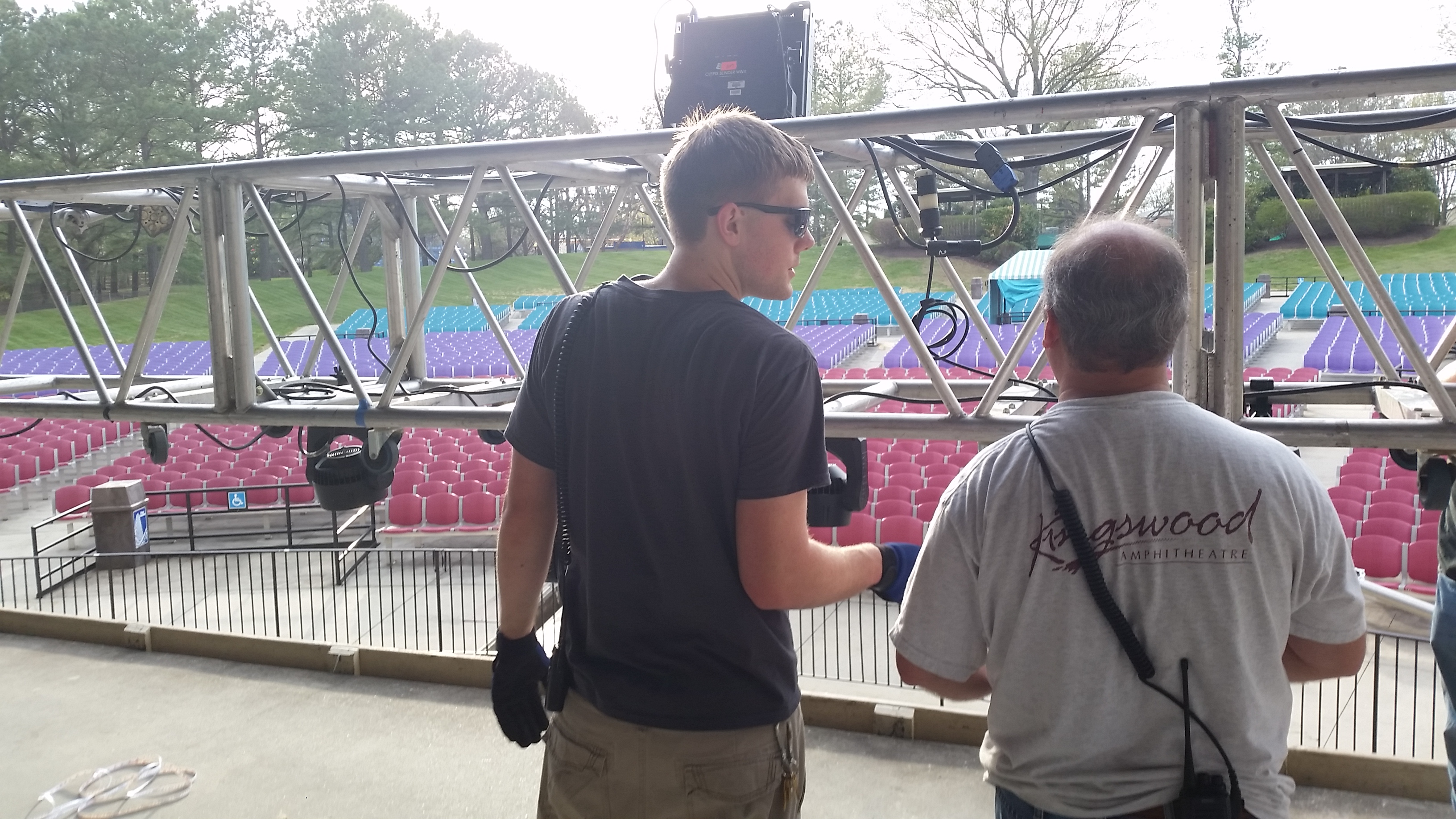 LSC production manager Jonathan Blake gets assistance from local crew in final stages of setup.