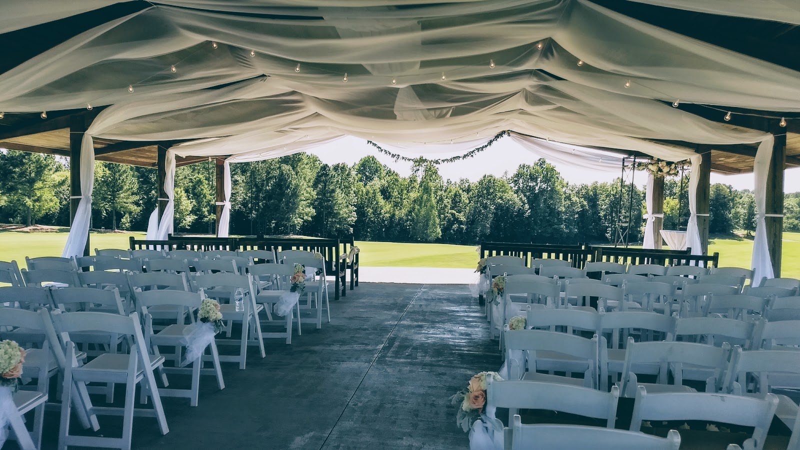 A white globe bistro accent for a drape canopy at Independence Golf Club