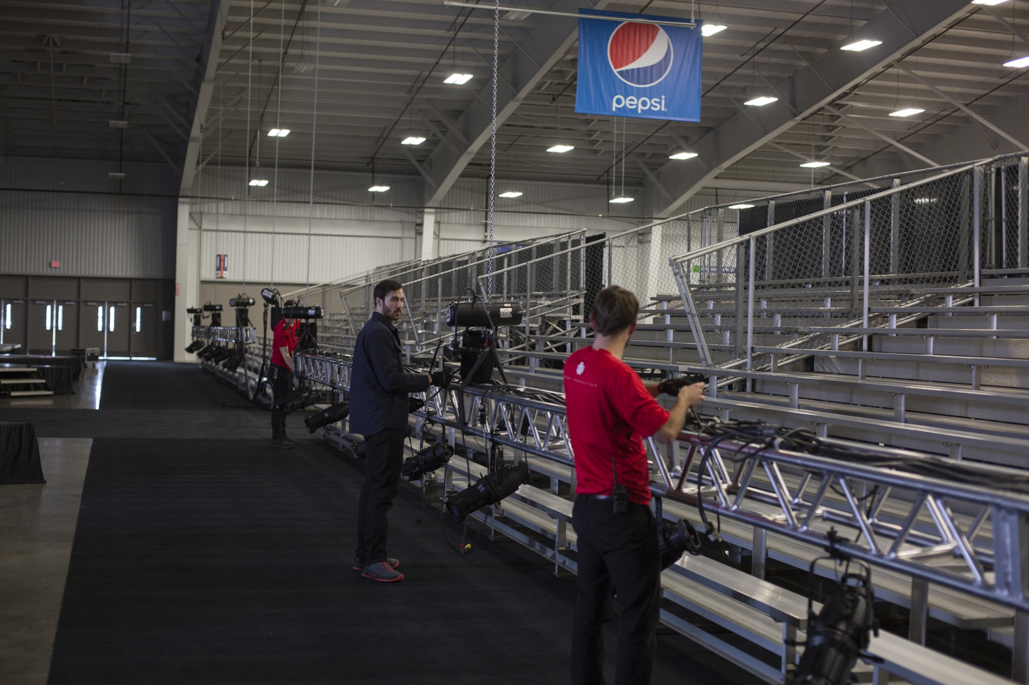 LSC Technicians assemble fixtures and cables on a lighting truss