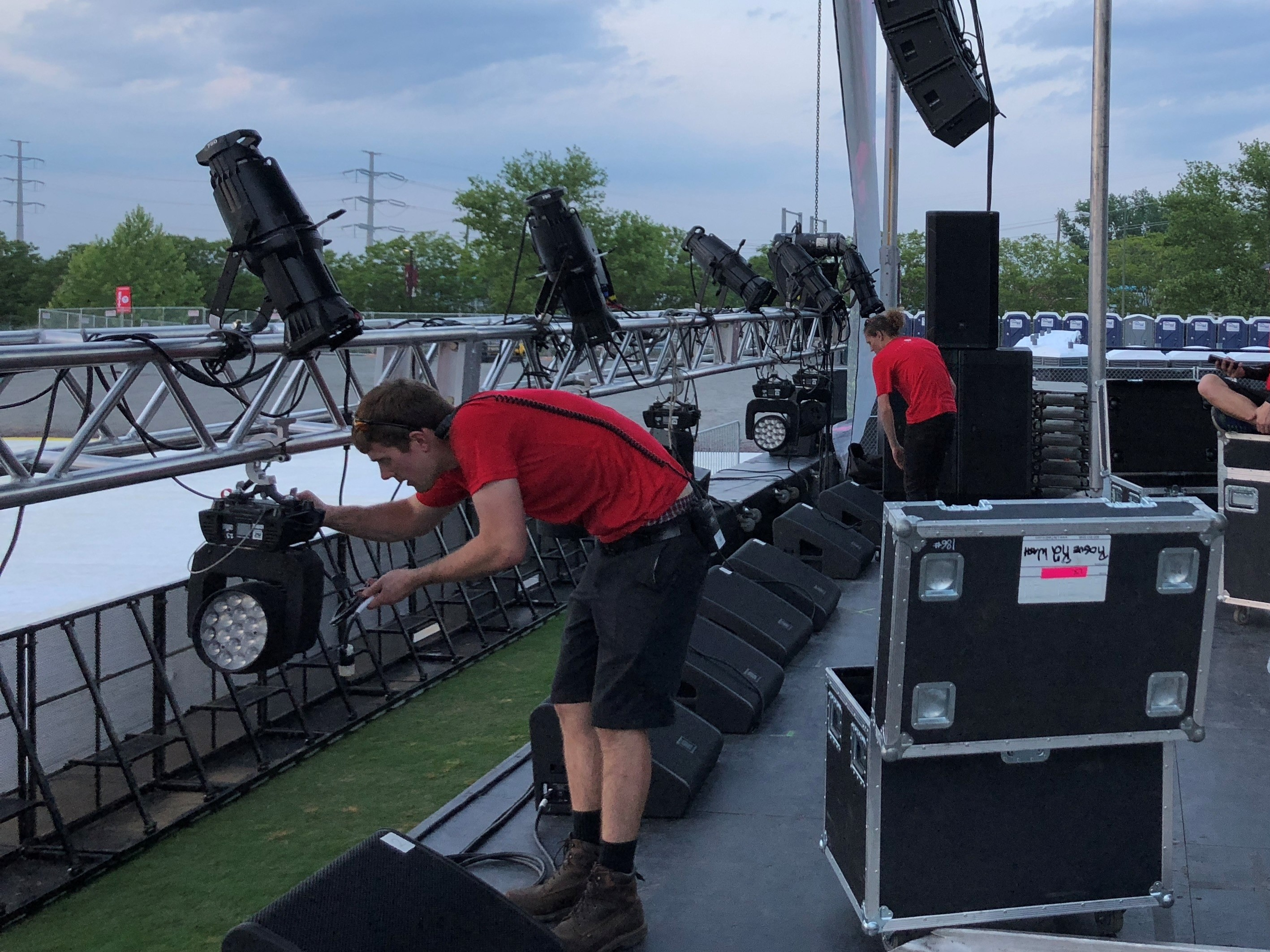Technicians from The Lighting & Sound Co set up stage lighting for Punk in Drublic, a large outdoor concert in Richmond, VA